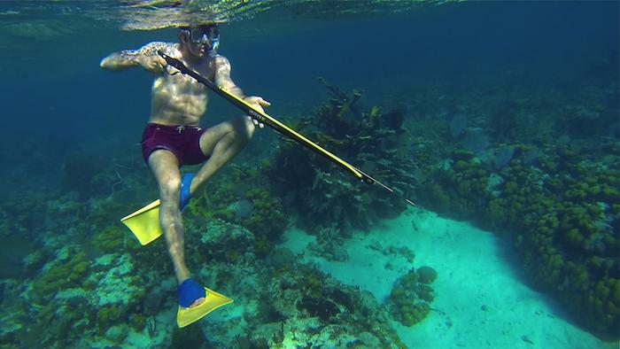 Caye Caulker snorkeling Belize Central America spear fishing aroundtheworldwithjustin.com