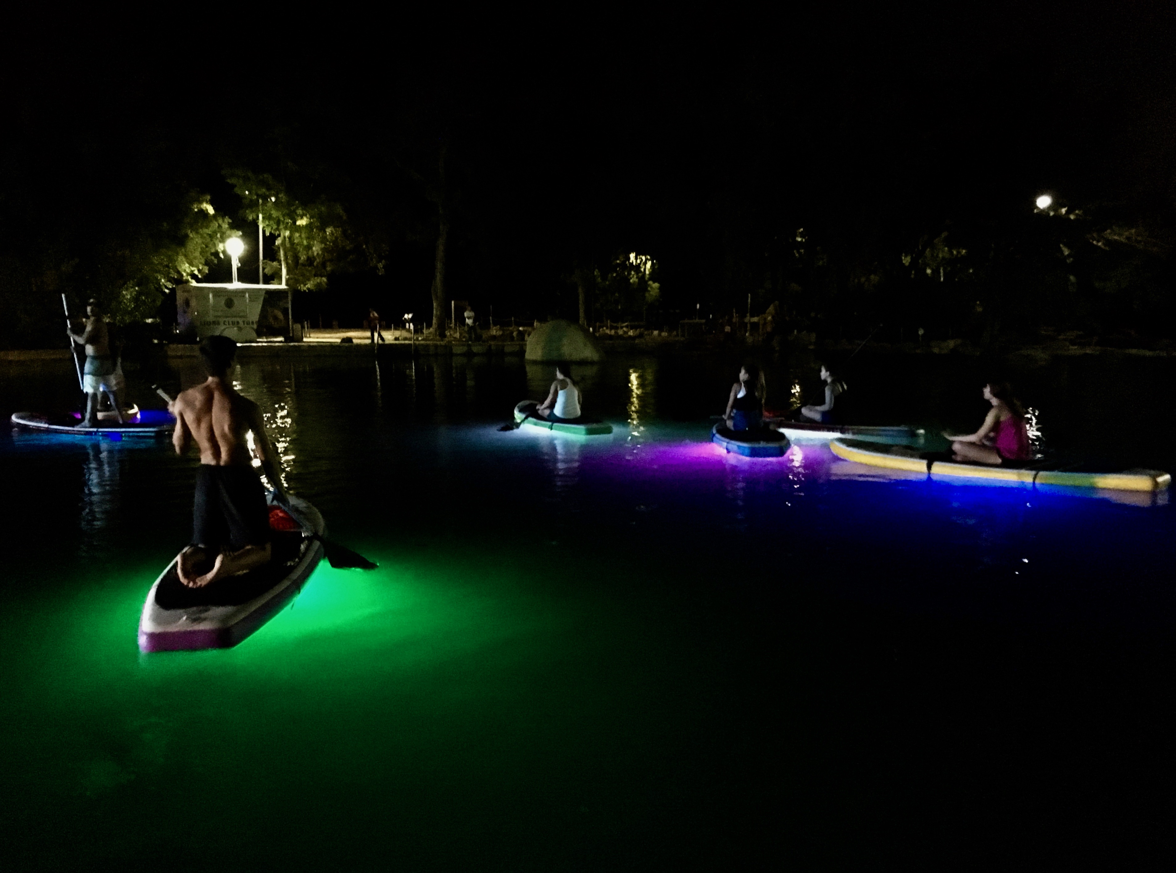 Things to do in San Marcos TX Glow SUP Glow-in-the-dark standup paddleboating paddlesmtx