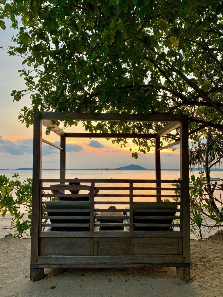 Cempedak Island Indonesia private island beach sunset